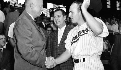 This May 29, 1959, file photo shows Harmon Killebrew, of the Washington Senators, shaking hands with President Dwight D. Eisenhower before the start of a baseball game against Boston, in Washington. At center is Calvin Griffith, president of the Senators. Hall of Famer Killebrew, known for his tape-measure home runs, died Tuesday, May 17, 2011, at his home in Scottsdale, Ariz. He was 74. (AP Photo/Harvey Georges, File)