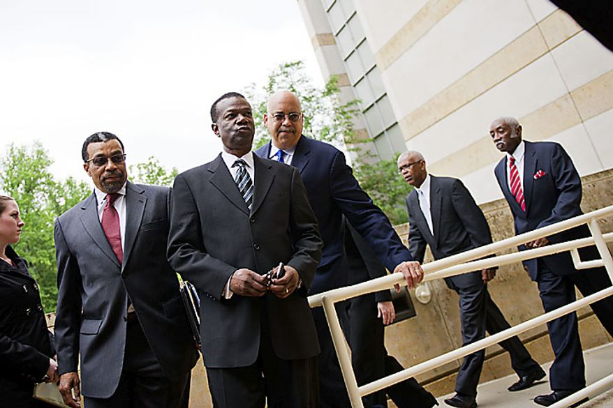 Former Prince George's County Executive Jack B. Johnson arrives at the U.S. Federal Courthouse in, in Greenbelt, Md., Tuesday, May 17, 2011. At left is his lawyer Billy Martin. (Drew Angerer/The Washington Times)