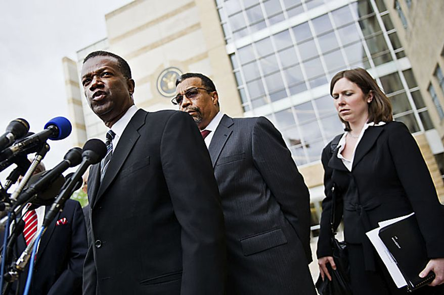 Former Prince George's County Executive Jack B. Johnson, left, and lawyer Billy Martin, speak to the media outside the U.S. Federal Courthouse, in Greenbelt, Md., Tuesday, May 17, 2011. Johnson pleaded guilty to one count of extortion and one count of witness tampering. (Drew Angerer/The Washington Times)