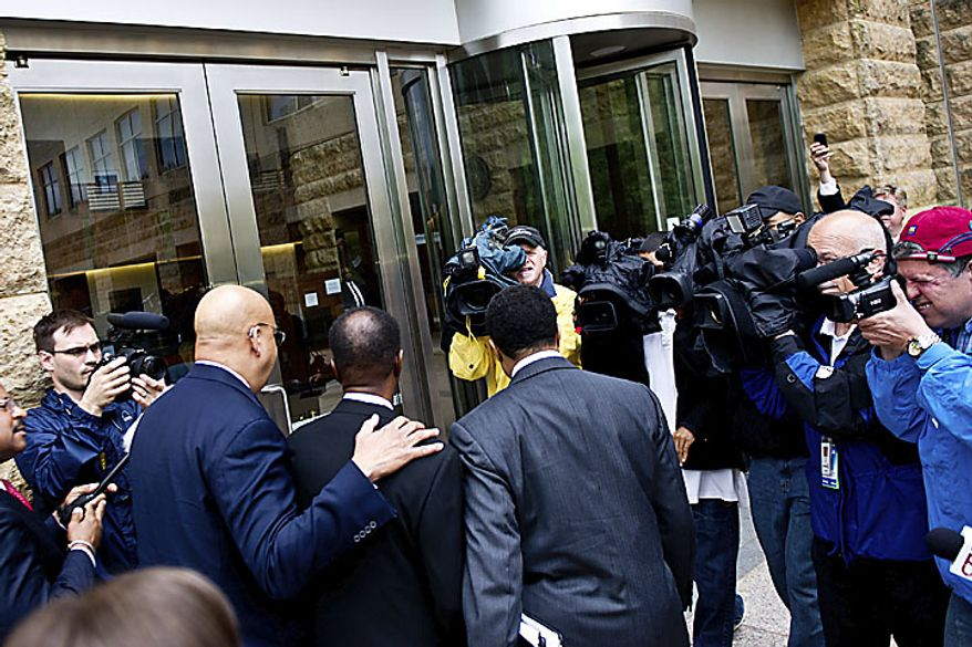The media surrounds former Prince George's County Executive Jack B. Johnson as he arrives at the U.S. Federal Courthouse in, in Greenbelt, Md., Tuesday, May 17, 2011. (Drew Angerer/The Washington Times)
