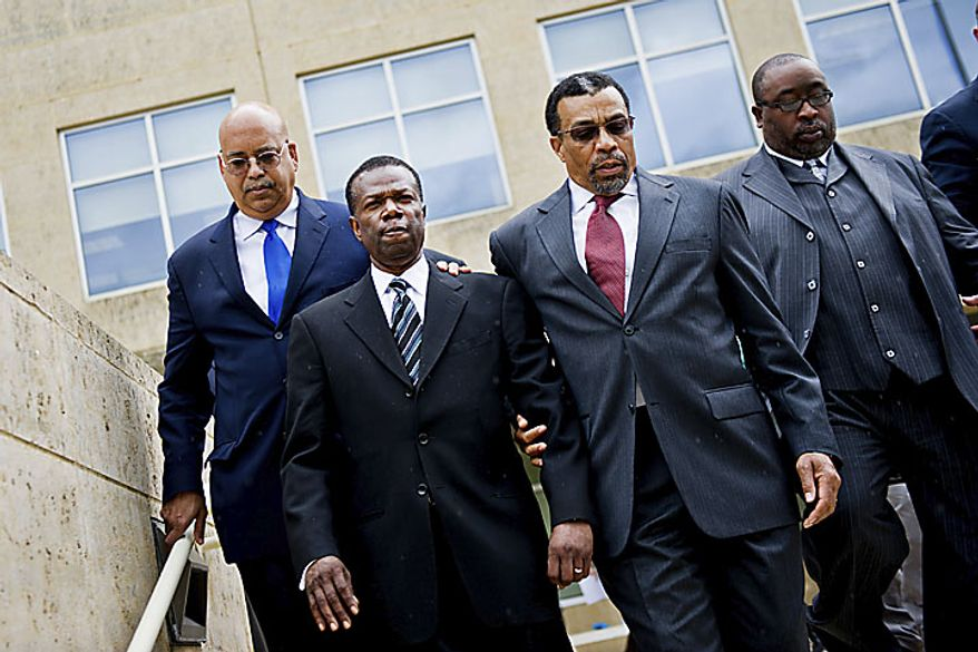 Former Prince George's County Executive Jack B. Johnson, arm and arm with his lawyer Billy Martin, leaves the U.S. Federal Courthouse, in Greenbelt, Md., Tuesday, May 17, 2011. Johnson pleaded guilty to one count of extortion and one count of witness tampering. (Drew Angerer/The Washington Times)