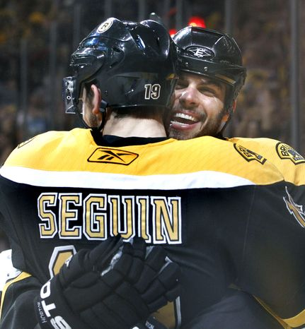 Boston Bruins center Tyler Seguin (19) is hugged by Boston Bruins right wing Nathan Horton after Seguin scored against the Tampa Bay Lightning in the second period of Game 2 of the NHL hockey Stanley Cup Eastern Conference final playoff series in Boston Tuesday, May 17, 2011. (AP Photo/Elise Amendola)