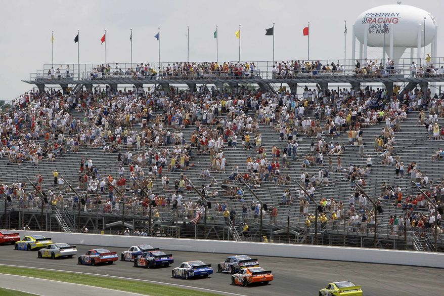 In this July 25, 2010, file photo, the field passes a half-full stand during the running of the NASCAR Brickyard 400 auto race at the Indianapolis Motor Speedway in Indianapolis. Indianapolis Motor Speedway CEO Jeff Belskus said that tickets sales for the July Brickyard 400 have been below that of last years race. (AP Photo/Darron Cummings, File)