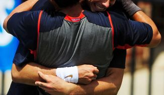 ASSOCIATED PRESS Virginia's Drew Courtney celebrated with teammate Michael Shabaz after winning the NCAA men's doubles Championship over Tennessee in Athens, Ga.