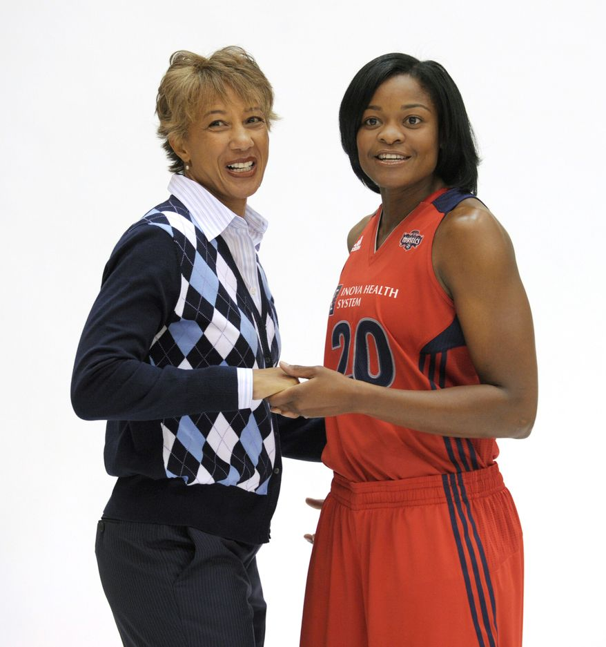 ASSOCIATED PRESS Washington Mystics general manager and coach Trudi Lacey (left) shares a moment with guard Alana Beard during media day at Verizon Center. Beard, a four-time All-Star, missed all of last season with an Achilles' tendon injury.