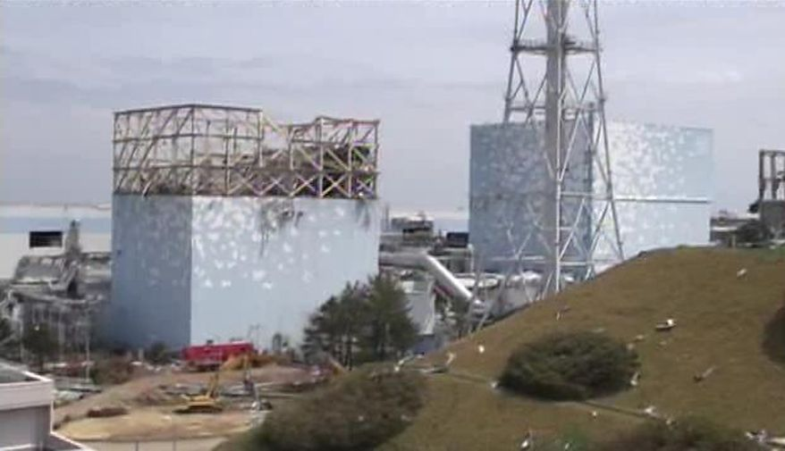 This photo from May 6, 2011, shows the reactor buildings of Unit 1 (left) and 2 at the crippled Fukushima Dai-ichi nuclear power plant in Okuma, Fukushima Prefecture, northeastern Japan. (Associated Press/Tokyo Electric Power Co.)