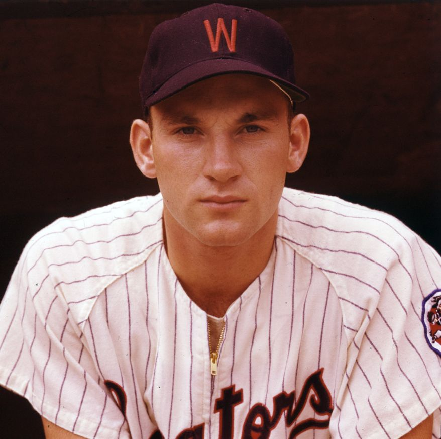 In this August 1959 file photo, Washington Senators outfielder Harmon Killebrew poses for a portrait. Killebrew, the affable, big-swinging Hall of Famer whose tape-measure home runs made him the cornerstone of the Minnesota Twins, died Tuesday, May 17, 2011 at his home in Scottsdale, Ariz., after battling esophageal cancer. He was 74. Killebrew broke in to the majors with the Senators in 1954 as an 18-year-old. (AP Photo/File)