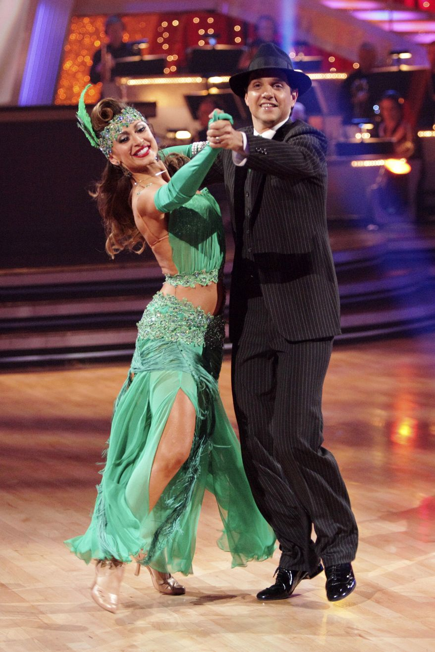 "In this publicity image released by ABC, Ralph Macchio (right) and his partner Karina Smirnoff perform on the celebrity dance competition series ""Dancing with the Stars,"" on May 2, 2011, in Los Angeles. (Associated Press/ABC, Adam Taylor)"