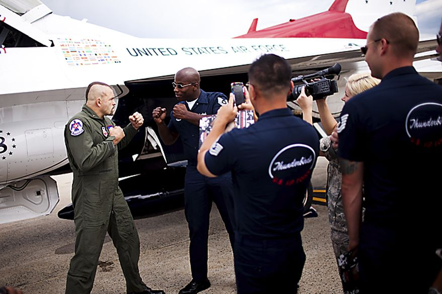 UFC Fighter Chuck Liddell poses for photos with U.S. Air Force Thunderbird crew members, at Andrews Air Force Base, Thursday, May 19, 2011. Liddell got to fly along during their practice session. (Drew Angerer/The Washington Times)