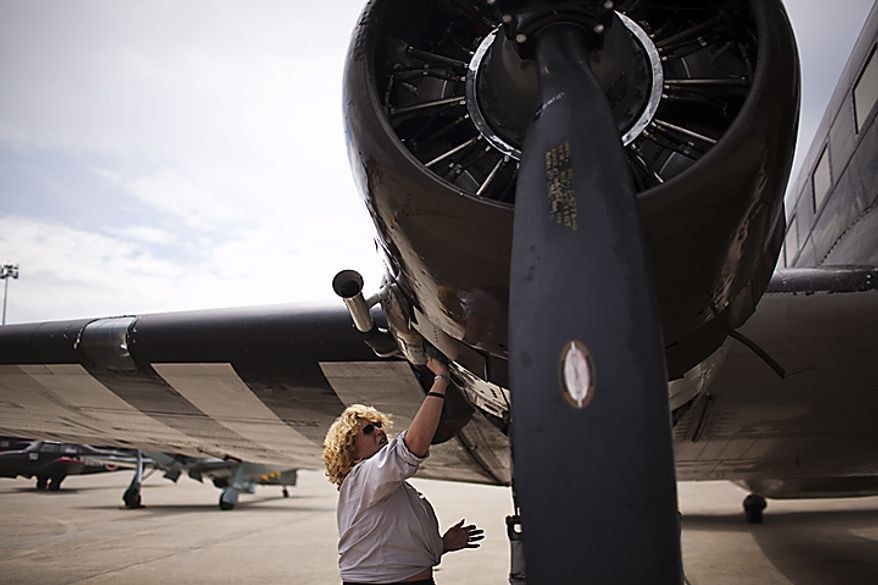 Naomi Wadsworth, of Geneseo, N.Y., polishes up a 1941 DC3-C47 airplane, at Andrews Air Force Base, Thursday, May 19, 2011. The plane was used to drop troops into the Normandy area during World War II, said Wadsworth. (Drew Angerer/The Washington Times)