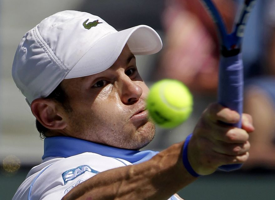Andy Roddick, of the United States, returns a shot to fellow countryman James Blake during a BNP Paribas Open tennis tournament match in Indian Wells, Calif, that took place in the middle of March. Earlier this month, for the first time in more than 35 years of computerized rankings, no player from the U.S. appeared in the ATP or WTA top 10. Plus, the last American man to win a Grand Slam singles title was Roddick, at the 2003 U.S. Open - 29 major tournaments ago. (AP Photo/Darron Cummings, File)