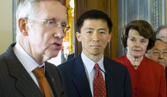 From left: Senate Majority Leader Harry Reid, Nevada Democrat, speaks on May 18, 2011, with judicial nominee Goodwin Liu and Sens. Diane Feinstein, California Democrat, and Daniel Inouye, Hawaii Democrat, on Capitol Hill. (Associated Press)