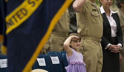 Avery Henson, 4, Command Master Chief Fred Prindle, and Avery's mother, Jeniece, salute during the playing of the National Anthem, during the 2010 Sailor of the Year ceremony at the U.S. Navy Memorial in Washington, D.C., Thursday, May 19, 2011. Avery's father, USN AWF1 (NAC/AW) James L. Henson was the recipient of the award, which was created in 1972 to recognize the outstanding Sailors of the Atlantic and Pacific Fleets. (Rod Lamkey Jr./The Washington Times)