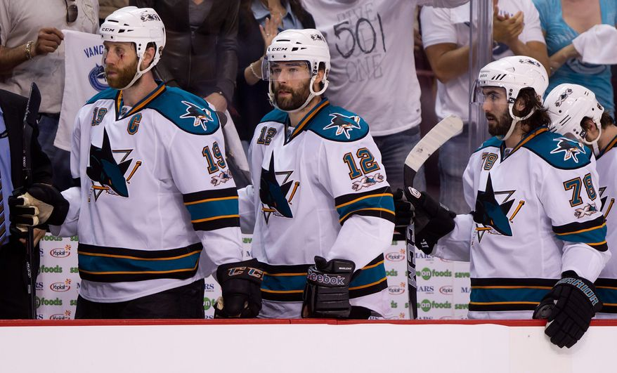 San Jose Sharks' Joe Thornton, left, Patrick Marleau, center, and Benn Ferriero leave the bench after losing 7-3 to the Vancouver Canucks during game 2 of the NHL Western Conference Final Stanley Cup playoff hockey series in Vancouver, British Columbia, on Wednesday May 18, 2011. (AP Photo/THE CANADIAN PRESS/Darryl Dyck)