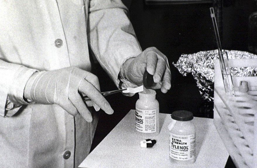 **FILE** In this photo from October 1982, bottles of Extra-Strength Tylenol are tested with a chemically treated paper that turns blue in the presence of cyanide, at the Illinois Department of Health in Chicago. (Associated Press)