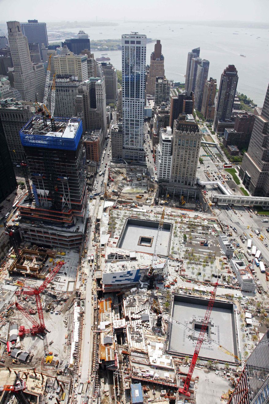 ** FILE ** The National September 11 Memorial and Museum is under construction, lower right, Tuesday, May 3, 2011, at the World Trade Center site in New York. The memorial is scheduled to open to the public in time for the 10th anniversary to be held Sept. 11, 2011. (AP Photo/Mark Lennihan)