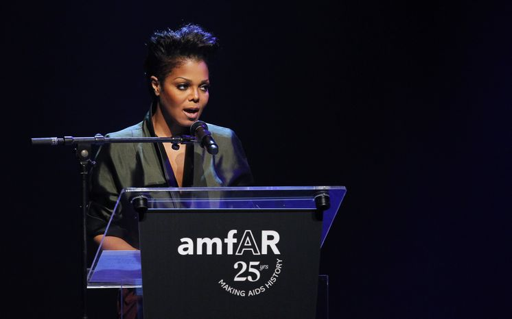 Singer Janet Jackson speaks on stage during the amfAR Cinema Against AIDS benefit at the Hotel du Cap-Eden-Roc, during the 64th Cannes international film festival, in Cap d&amp