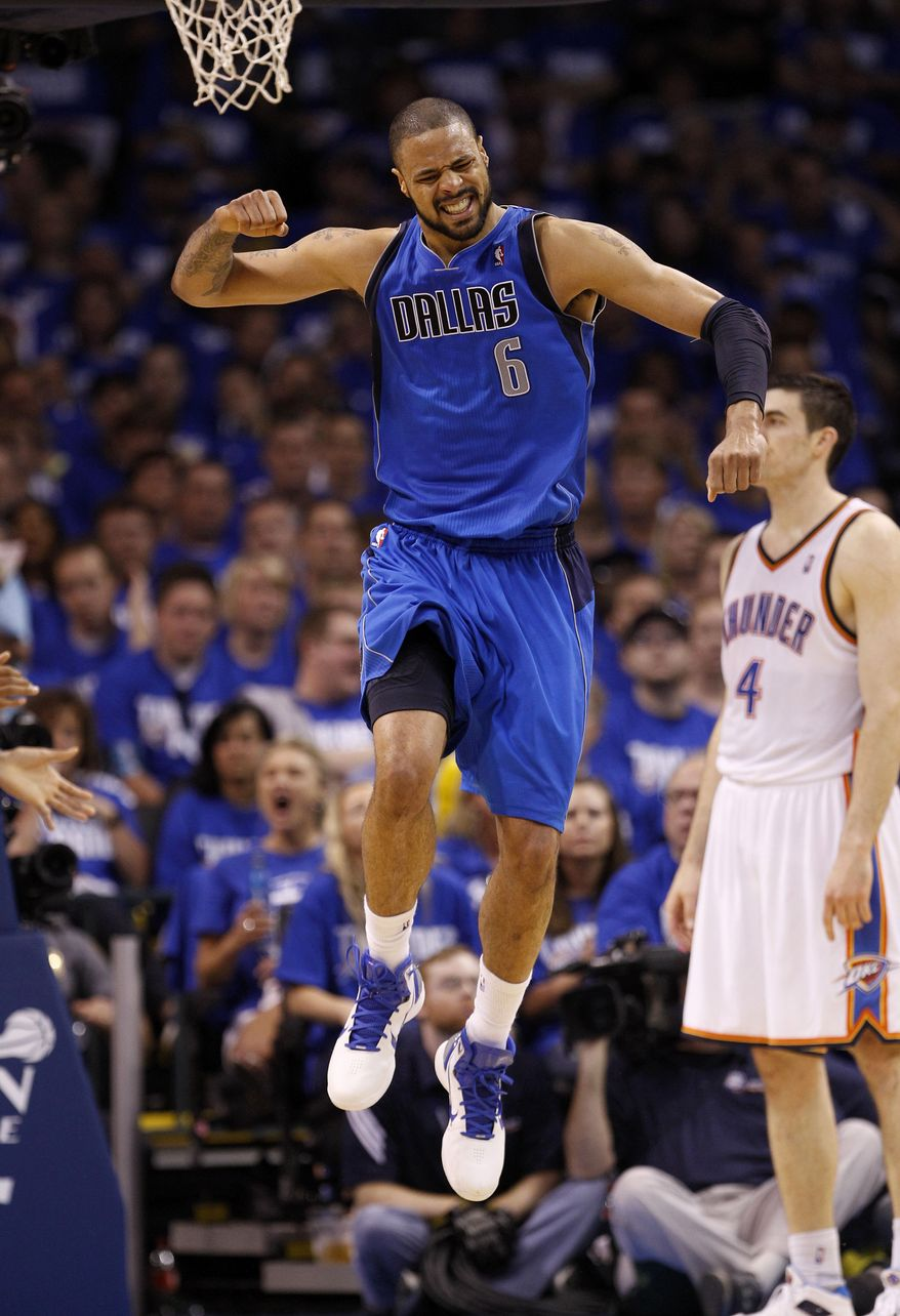 NBA Playoffs: Dallas Mavericks' Tyson Chandler (6) reacts after dunking as Oklahoma City Thunder's Nick Collison (4) walks in the background during Game 3 of the NBA Western Conference finals basketball series Saturday, May 21, 2011, in Oklahoma City. The Mavericks won Game 3 against the Thunder 93-87. (AP Photo/Eric Gay)