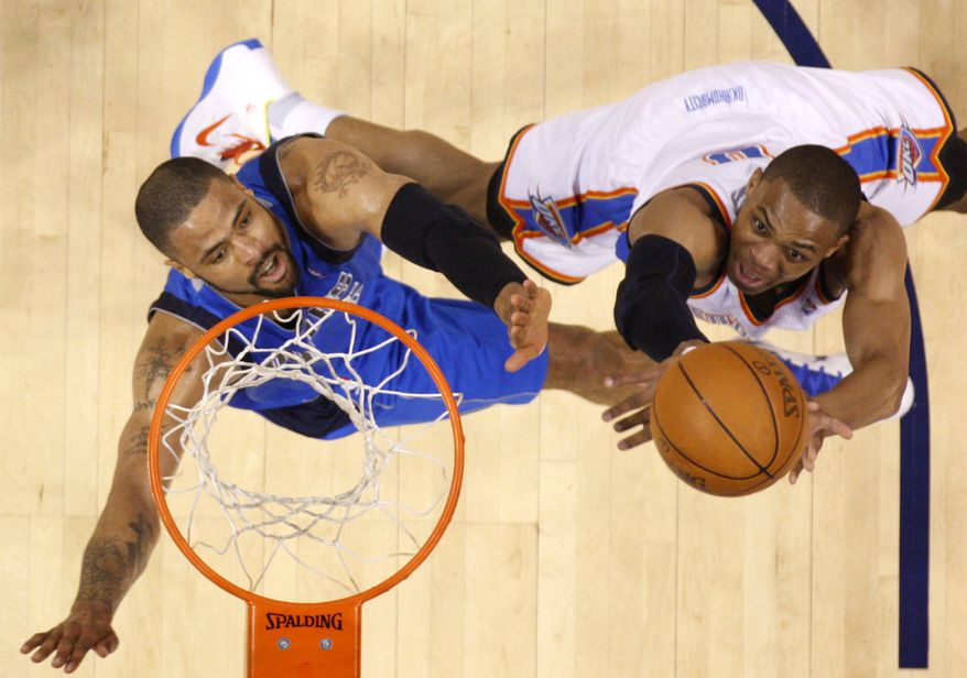 NBA Playoffs: Oklahoma City Thunder's Russell Westbrook, right, attempts a shot over Dallas Mavericks' Tyson Chandler, left, during Game 3 of the NBA Western Conference finals basketball series Saturday, May 21, 2011, in Oklahoma City. (AP Photo/Sue Ogrocki)