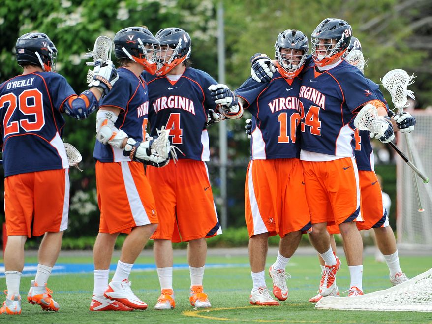Virginia's Chris Bocklet (10) is congratulated on his goal by Nicke O'Reilly (29), Steele Stanwick (6), Matt White (4) and Rob Emery (24) in the second quarter against Cornell in an NCAA Division I men's lacrosse tournament quarterfinal at Hofstra University on Saturday, May 21, 2011, in Hempstead, N.Y. Stanwick and Bocklet each scored three goals during Virginia's 13-9 victory. (AP Photo/Kathy Kmonicek)