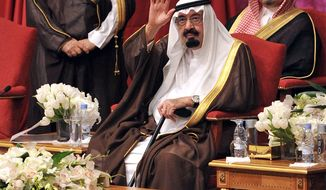 ** FILE ** King Abdullah (center) of Saudi Arabia waves during the inauguration of the Princess Noura bint Abdulrahaman University in Riyadh, Saudi Arabia, on Sunday, May 15, 2011. The school will be the biggest women's university in the world, with capacity for 40,000 students. (AP Photo/Saudi Press Agency)
