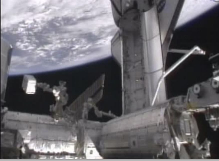 This image provided by NASA televsion shows the space shuttle Endeavour's tiles being inspected early Saturday morning May 21, 2011, using both the shuttle's robot arm and the International Space Station's robot arm. (AP Photo/NASA)