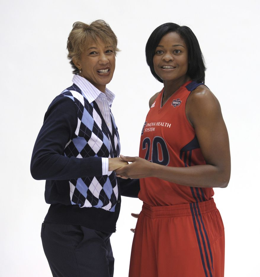 Washington Mystics general manager and head coach Trudi Lacey, left, poses with guard Alana Beard, right, during a photo shoot during WNBA basketball media day at the Verizon Center in Washington, Wednesday, May 18, 2011. The Mystics played their first scrimmage Saturday against the Chinese National Team, and Beard played her first game after missing all of last season with an Achilles injury. Lacey is a coach who will emphasize defense and rebounding with her young squad this season. (AP Photo/Susan Walsh)