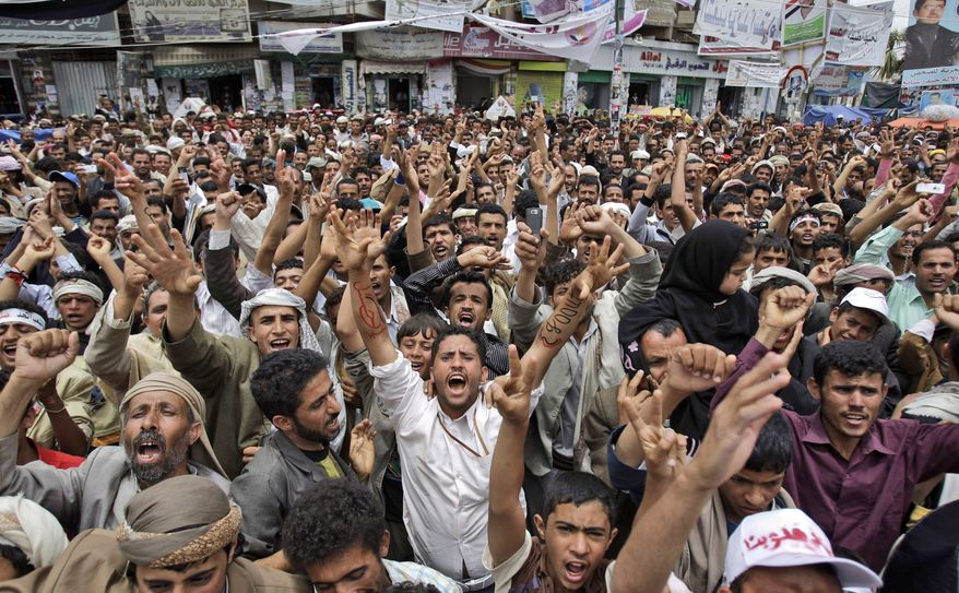 Anti-government protesters chant slogans during a demonstration demanding the resignation of Yemeni President Ali Abdullah Saleh in Sanaa, Yemen, on Saturday, May 21, 2011. (AP Photo/Hani Mohammed)