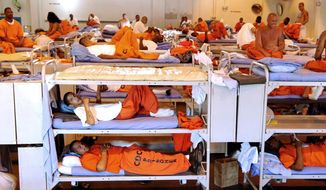 Inmates pass the time in cramped conditions at California State Prison in Los Angeles. The Supreme Court on Monday endorsed a court order requiring California to cut its prison population by more than 30,000 inmates to improve overall health care. (California Department of Corrections via Associated Press)