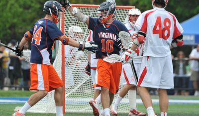 ASSOCIATED PRESS Chris Bocklet (10) celebrated a goal with Rob Emery (24) during Virginia's NCAA quarterfinal win over Cornell on Saturday.