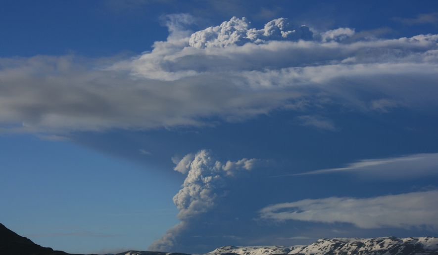 Smoke rises from Iceland's Grimsvotn, the island nation's most active volcano, on Saturday, May 21, 2011. (AP Photo/Halldora Kristin Unnarsdottir)