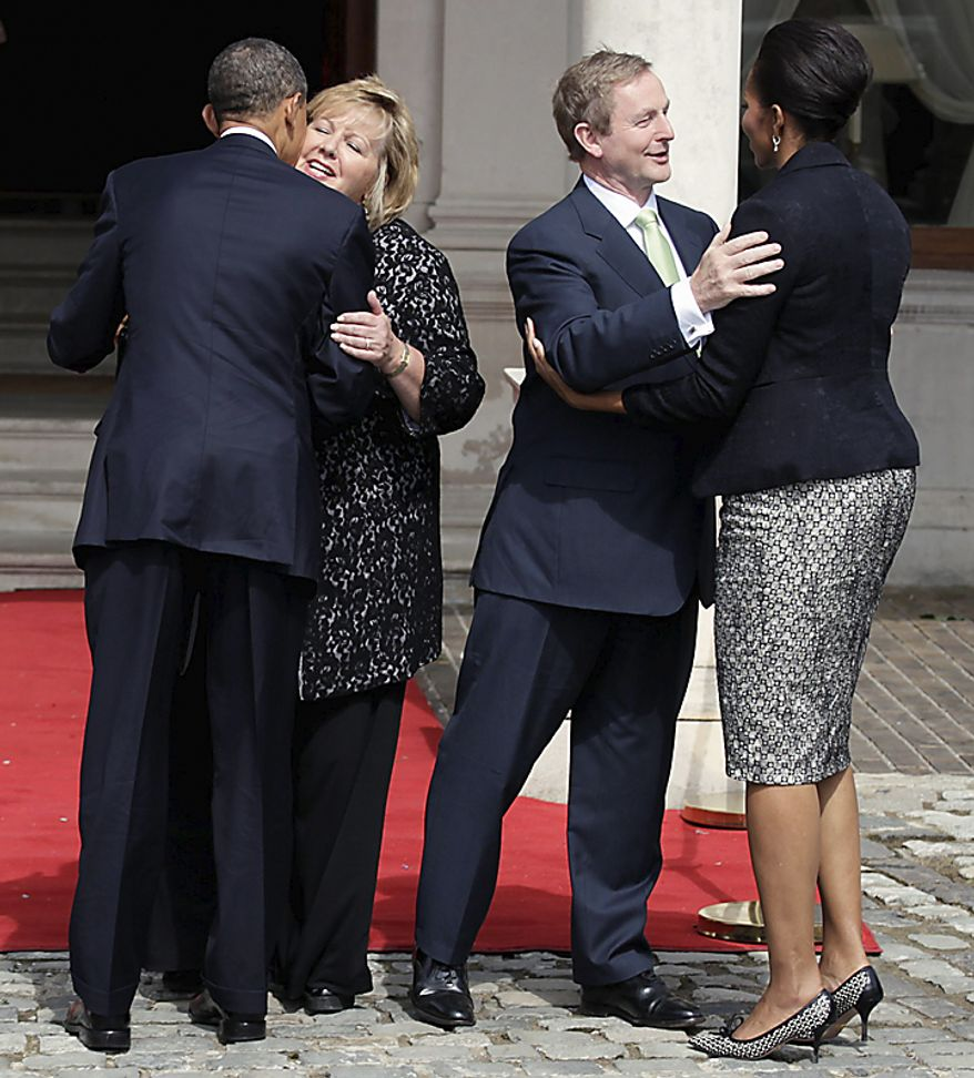 President Barack Obama, left, and first lady Michelle Obama, right, are greeted by Ireland's Taoiseach Enda Kenny, second from right, and his wife Fionnuala Kenny as they arrive at Farmleigh House in Dublin, Ireland, Monday, May 23, 2011. (AP Photo/Carolyn Kaster)