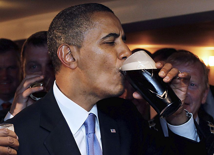 ** FILE ** U.S. President Barack Obama drinks Guinness beer at Ollie Hayes pub in Moneygall, Ireland, May 23, 2011. (AP Photo/Charles Dharapak)