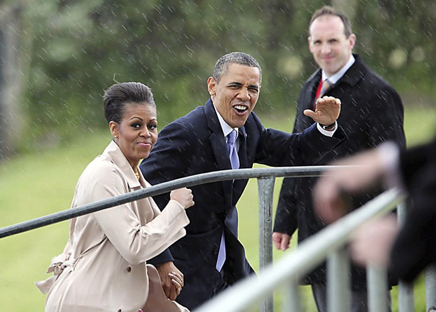 U.S. President Barack Obama and first lady Michelle Obama during their visit to Moneygall, Ireland, the ancestral homeland of his great-great-great grandfather, Monday, May 23, 2011. President Barack Obama opens a six-day European tour with a quick dash through Ireland, where he will celebrate his own Irish roots and look to give a boost to a nation grappling with the fallout from its financial collapse. (AP Photo, Pool)
