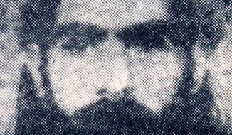 ** FILE ** This undated photo reportedly shows the Taliban supreme leader Mullah Omar. (AP Photo/File)