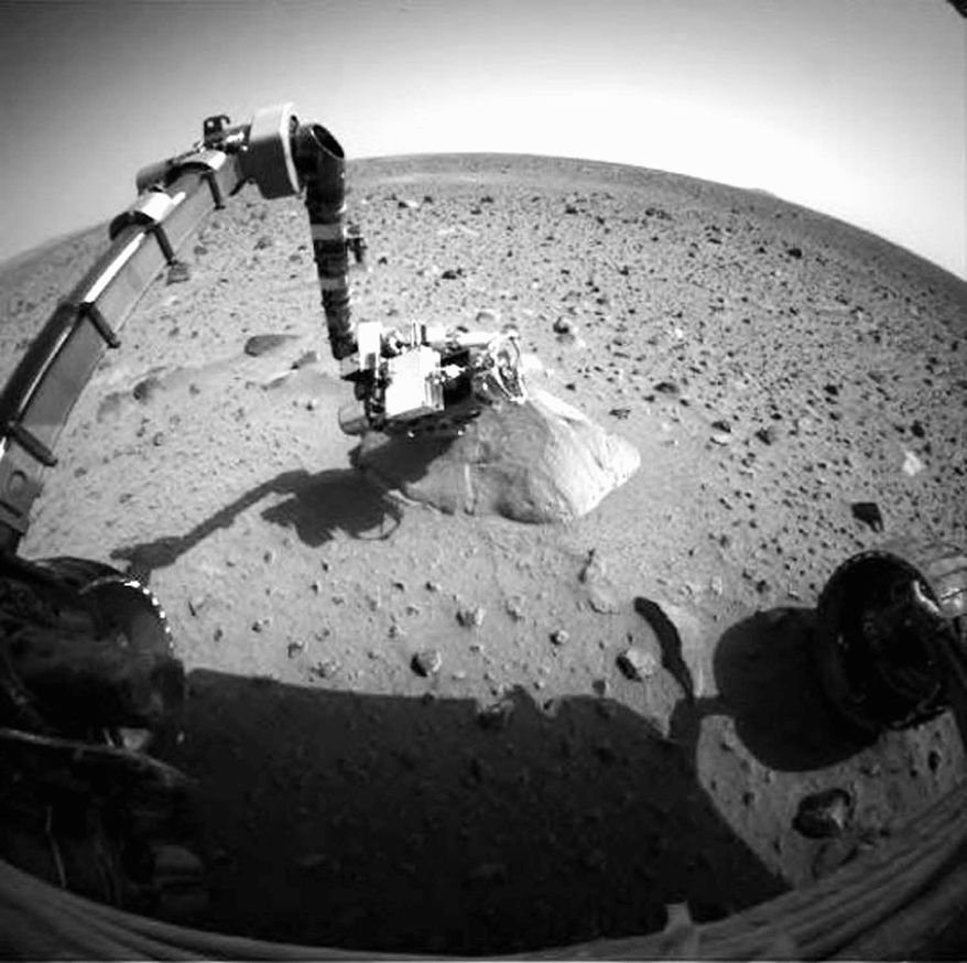 A photo taken by NASA's Mars Exploration Rover Spirit in 2008 shows the Martian landscape. NASA is ending efforts to revive the immobilized robot. (NASA via Associated Press)