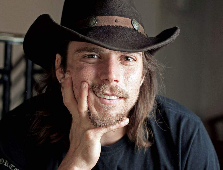 Lukas Nelson, the son of country music great Willie Nelson, is a guitarist in his own right and will play with his father on a tour that begins Friday in Philadelphia. (Associated Press)