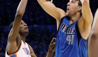 NBA Playoffs: Dallas Mavericks' forward Dirk Nowitzki, guarded by Oklahoma City's Kevin Durant, scored 40 points in the Mavericks' 112-105 overtime victory in Game 4 of the Western Conference finals Monday night. Durant scored 29 for the Thunder but missed his last six shots. (Associated Press)