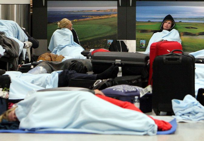 Weary passengers wait for flights to resume in Edinburgh, Scotland. A dense ash cloud from an Icelandic volcano raised fears of a repeat of last year's huge travel disruptions in Europe. (Associated Press)