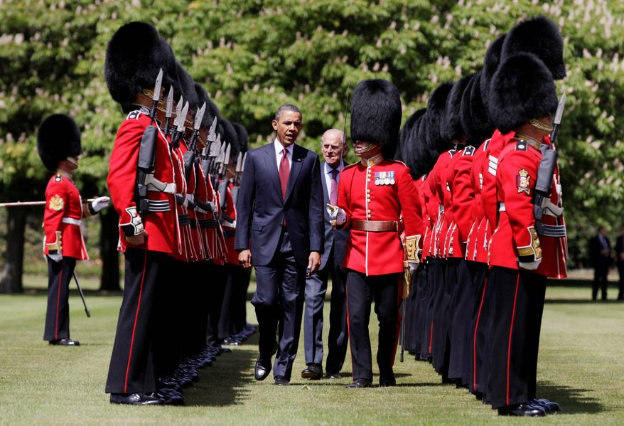 President Obama and Britain's Prince Philip review the Scots Guard during an official arrival ceremony at Buckingham Palace in London on Tuesday. (Associated Press)