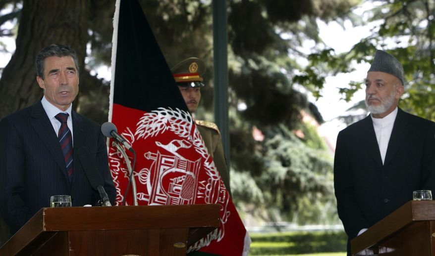 NATO Secretary-General Anders Fogh Rasmussen (left) and Afghan President Hamid Karzai have a joint press conference at the Presidential Palace in Kabul, Afghanistan, on Tuesday, May 24, 2011. (AP Photo/Mustafa Quraishi)