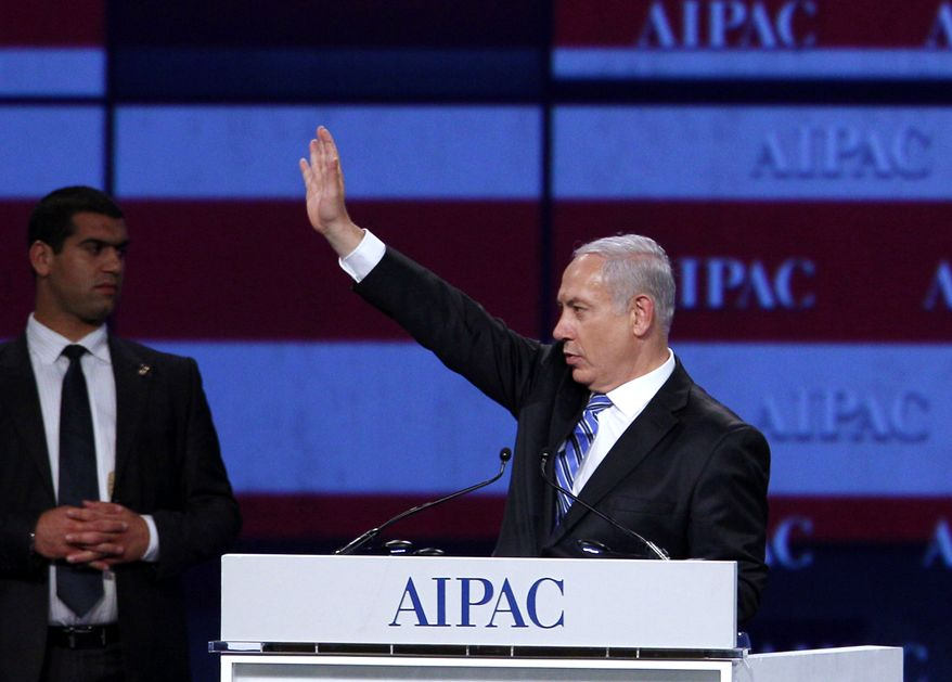 Israeli Prime Minister Benjamin Netanyahu waves to the crowd at the American Israel Public Affairs Committee meeting in Washington on Monday, May 23, 2011. (AP Photo/Jose Luis Magana)