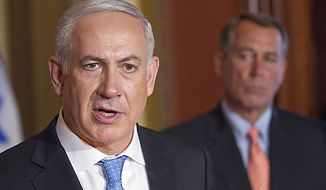House Speaker John Boehner of Ohio looks on at right as Israeli Prime Minister Benjamin Netanyahu makes a statement on Capitol Hill in Washington, Tuesday, May 24, 2011.  (AP Photo/Evan Vucci)