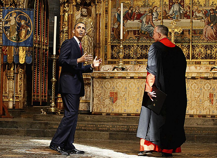 President Obama (left) talks with the Very Rev. John Hall, dean of Westminster Abbey, during the president's visit to the historic church in London on Tuesday, May 24, 2011. Mr. Obama, accompanied by first lady Michelle Obama, is on a two-day state visit to Britain. (AP Photo/Kirsty Wigglesworth)