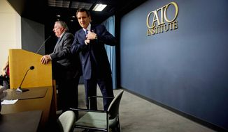 """We can't have the people getting paid by the taxpayers getting a better deal than the taxpayers themselves,"" presidential candidate Tim Pawlenty said at the Cato Institute on Wednesday. Institute President Ed Crane is at left. (Rod Lamkey Jr./The Washington Times)"