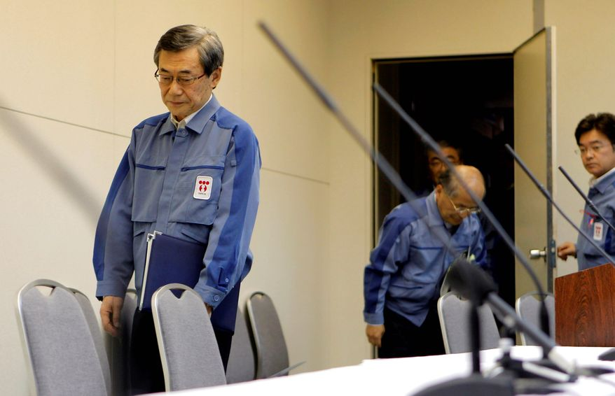 Tokyo Electric Power Co. President Masataka Shimizu arrives for a news conference at company headquarters in Tokyo on Friday to announce that he is stepping down. (Associated Press)
