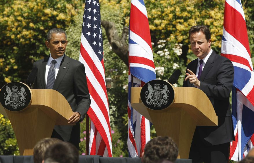 President Obama and British Prime Minister David Cameron participate in a joint news conference at Lancaster House in London on Wednesday, May 25, 2011. (AP Photo/Charles Dharapak)