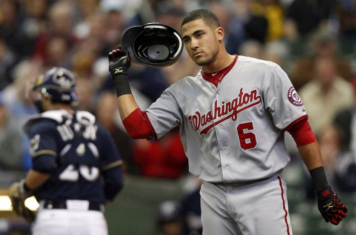 Nationals shortstop Ian Desmond reacts after striking out during Washington's 6-4 loss to Milwaukee. Brewers ace Zack Greinke struck out 10 in seven innings. (AP Photo/Jeffrey Phelps)