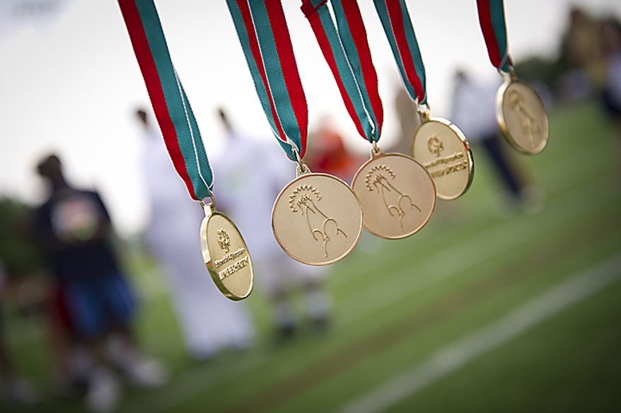 ** FILE ** Medals are presented following the Unified 4x100 meter relay during the 2011 Special Olympics D.C. Summer Games being held at Catholic University in Washington, D.C., Wednesday, May 25, 2011. (Rod Lamkey Jr./The Washington Times)