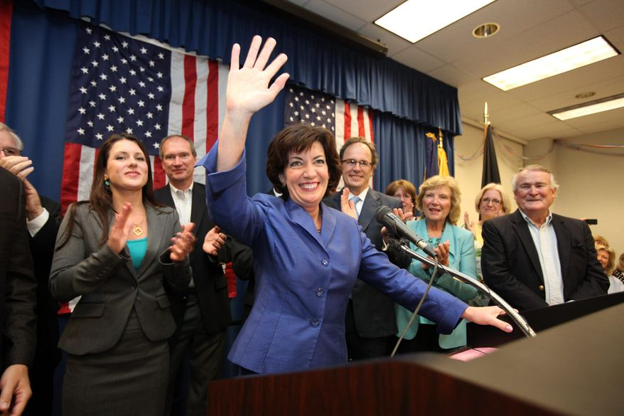 ** FILE ** Erie County Clerk Kathleen C. Hochul waves to the crowd at a union hall in Williamsville, N.Y., on Tuesday, May 24, 2011, after winning a special election in New York's 26th Congressional District. (Associated Press)
